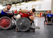 The 39th National Veterans Wheelchair Games kicked off in Louisville, Ky., today with a hard fought game of quad rugby. Chris Hull, left; and Mason Symons, right, put up a great battle that culminated in the Red Team winning 13-12.